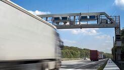 Truck toll system, german highway - control gantry, motion blur on truck